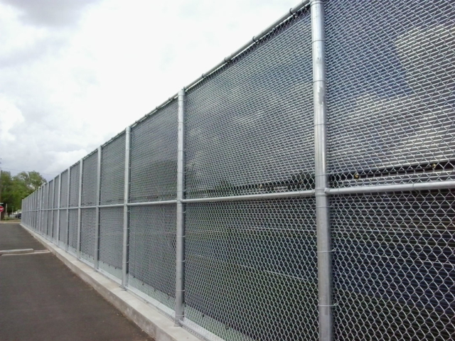 Closely spaced grommets and uv protected rope are used to fasten the custom sized screens to existing fencing with center lacing to provide years of functionality and durability.