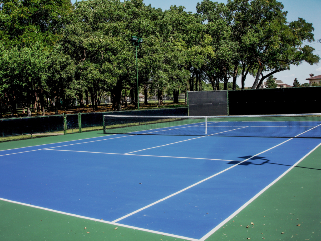 Windscreens for high school, college and public tennis courts provide wind protection and privacy.