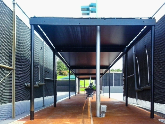 Large facilities benefit from the protection provided from the use of windscreens and mesh tarp canopies for players and spectators.