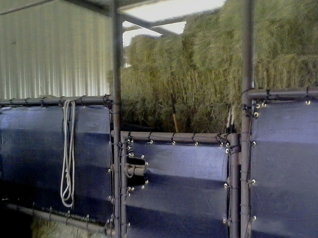Windscreen tarps add storage areas for hay, feed, and equipment. Screen material adds vision barrier for security while keeping products out of the elements.