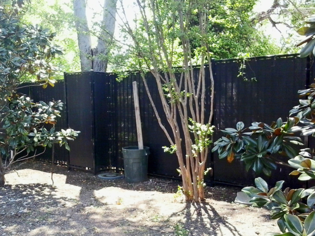 Hotels and other public areas gain privacy through the use of windscreens on fencing.