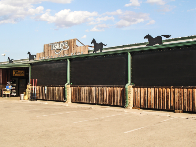 Commercial screens can be used to protect equipment and supplies outdoors and enhance customer shopping.