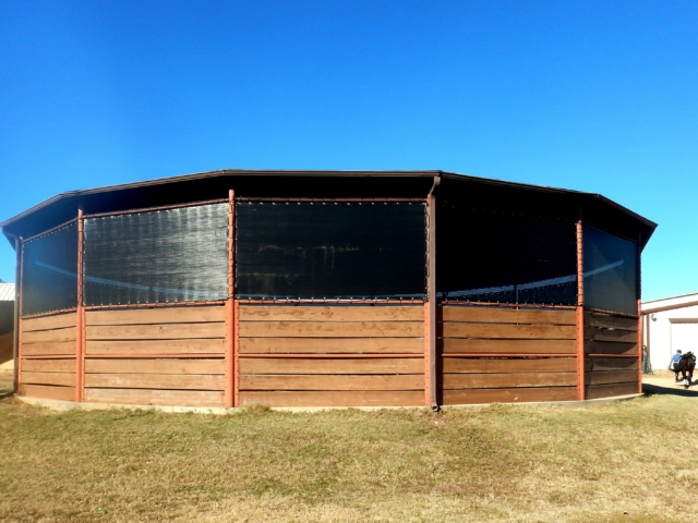 When it comes to hard work for horse and trainer a round pen has to be number one.  Make it better with a roof and sun screensto be usable all season long.